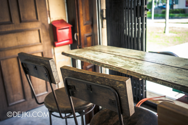Tian Kee & Co. Cafe - Bar seating facing Dakota residences